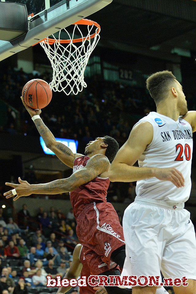 March 20, 2014: New Mexico State Aggies guard Daniel Mullings (23) gets a layup during a second round game of the NCAA Division I Men's Basketball Championship between the 4-seed San Diego State Aztecs and the 13-seed New Mexico State Aggies at Spokane Arena in Spokane, Wash. San Diego State defeated New Mexico State 73-69 in overtime.