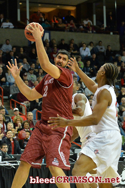 March 20, 2014: New Mexico State Aggies center Sim Bhullar (2) grabs a rebound during a second round game of the NCAA Division I Men's Basketball Championship between the 4-seed San Diego State Aztecs and the 13-seed New Mexico State Aggies at Spokane Arena in Spokane, Wash. San Diego State defeated New Mexico State 73-69 in overtime.