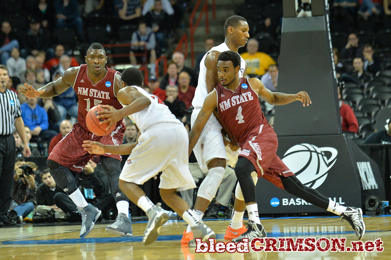 March 20, 2014: New Mexico State Aggies guard Ian Baker (4) fights through a screen during a second round game of the NCAA Division I Men's Basketball Championship between the 4-seed San Diego State Aztecs and the 13-seed New Mexico State Aggies at Spokane Arena in Spokane, Wash. San Diego State defeated New Mexico State 73-69 in overtime.