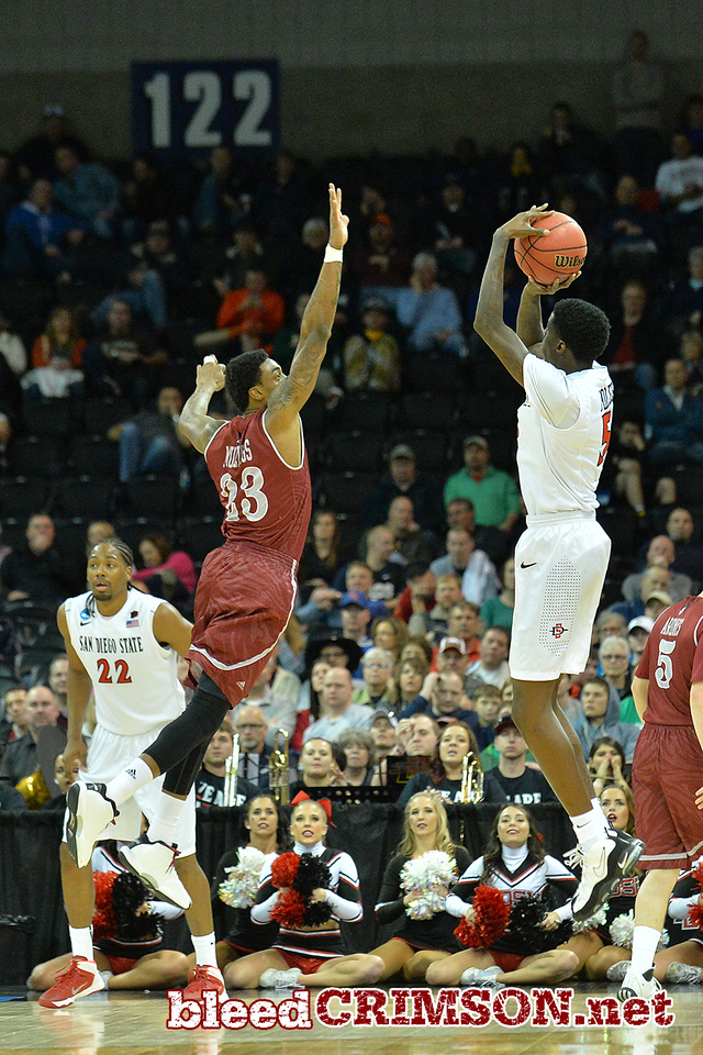 March 20, 2014: New Mexico State Aggies guard Daniel Mullings (23) contests a shot by San Diego State Aztecs forward Dwayne Polee II (5) during a second round game of the NCAA Division I Men's Basketball Championship between the 4-seed San Diego State Aztecs and the 13-seed New Mexico State Aggies at Spokane Arena in Spokane, Wash. San Diego State defeated New Mexico State 73-69 in overtime.