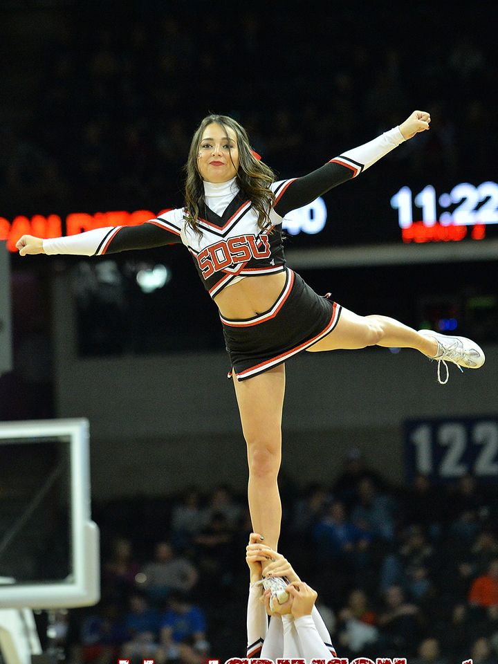 March 20, 2014: A member of the San Diego State Aztecs cheerleading squad performs during a second round game of the NCAA Division I Men's Basketball Championship between the 4-seed San Diego State Aztecs and the 13-seed New Mexico State Aggies at Spokane Arena in Spokane, Wash. San Diego State defeated New Mexico State 73-69 in overtime.