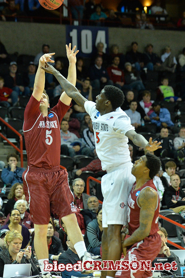 March 20, 2014: New Mexico State Aggies guard Kevin Aronis (5) takes a three point shot during a second round game of the NCAA Division I Men's Basketball Championship between the 4-seed San Diego State Aztecs and the 13-seed New Mexico State Aggies at Spokane Arena in Spokane, Wash. San Diego State defeated New Mexico State 73-69 in overtime.