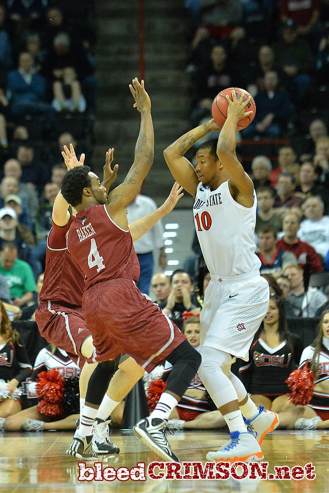 March 20, 2014: New Mexico State Aggies guard Ian Baker (4) traps San Diego State Aztecs guard Aqeel Quinn (10) during a second round game of the NCAA Division I Men's Basketball Championship between the 4-seed San Diego State Aztecs and the 13-seed New Mexico State Aggies at Spokane Arena in Spokane, Wash. San Diego State defeated New Mexico State 73-69 in overtime.