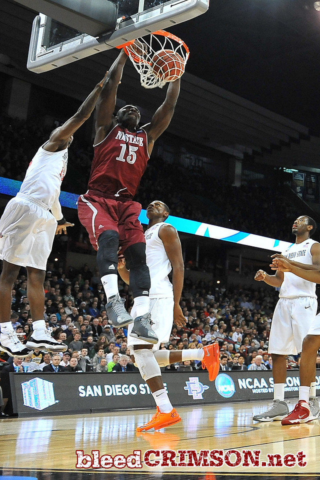 March 20, 2014: New Mexico State Aggies center Tshilidzi Nephawe (15) dunks during a second round game of the NCAA Division I Men's Basketball Championship between the 4-seed San Diego State Aztecs and the 13-seed New Mexico State Aggies at Spokane Arena in Spokane, Wash. San Diego State defeated New Mexico State 73-69 in overtime.