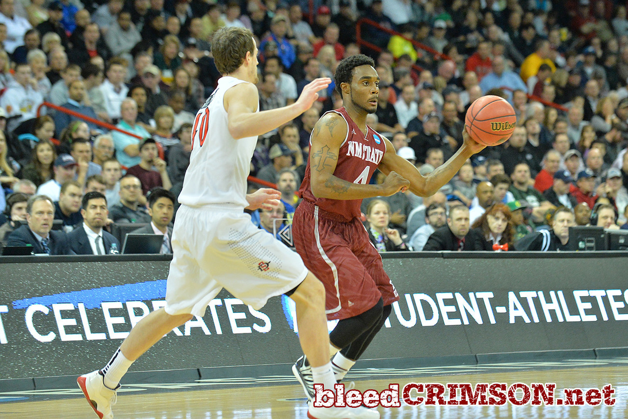 March 20, 2014: New Mexico State Aggies guard Ian Baker (4) passes the ball during a second round game of the NCAA Division I Men's Basketball Championship between the 4-seed San Diego State Aztecs and the 13-seed New Mexico State Aggies at Spokane Arena in Spokane, Wash. San Diego State defeated New Mexico State 73-69 in overtime.