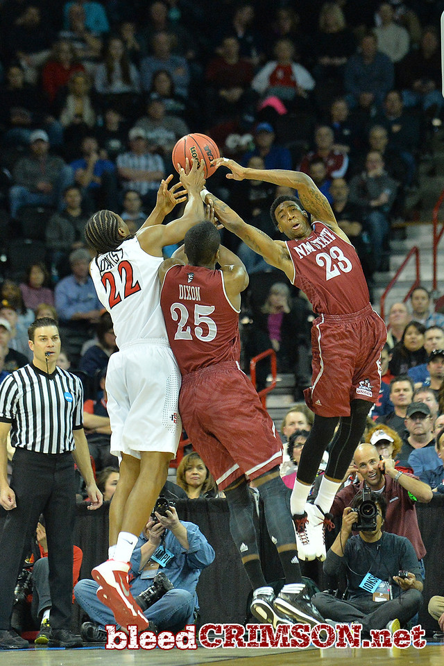 March 20, 2014: San Diego State Aztecs forward Josh Davis (22), New Mexico State Aggies forward Renaldo Dixon (25) and New Mexico State Aggies guard Daniel Mullings (23) battle for a rebound during a second round game of the NCAA Division I Men's Basketball Championship between the 4-seed San Diego State Aztecs and the 13-seed New Mexico State Aggies at Spokane Arena in Spokane, Wash. San Diego State defeated New Mexico State 73-69 in overtime.