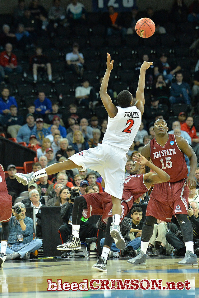March 20, 2014: San Diego State Aztecs guard Xavier Thames (2) shoots over New Mexico State Aggies guard Ian Baker (4) during a second round game of the NCAA Division I Men's Basketball Championship between the 4-seed San Diego State Aztecs and the 13-seed New Mexico State Aggies at Spokane Arena in Spokane, Wash. San Diego State defeated New Mexico State 73-69 in overtime.