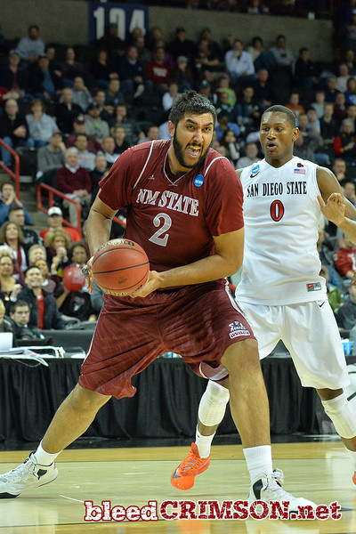 March 20, 2014: New Mexico State Aggies center Sim Bhullar (2) drives toward the basket during a second round game of the NCAA Division I Men's Basketball Championship between the 4-seed San Diego State Aztecs and the 13-seed New Mexico State Aggies at Spokane Arena in Spokane, Wash. San Diego State defeated New Mexico State 73-69 in overtime.