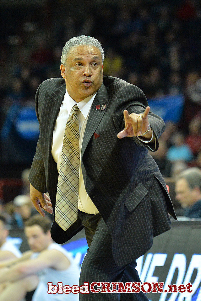 March 20, 2014: New Mexico State Aggies head coach Marvin Menzies shouts instructions to his team during a second round game of the NCAA Division I Men's Basketball Championship between the 4-seed San Diego State Aztecs and the 13-seed New Mexico State Aggies at Spokane Arena in Spokane, Wash. San Diego State defeated New Mexico State 73-69 in overtime.