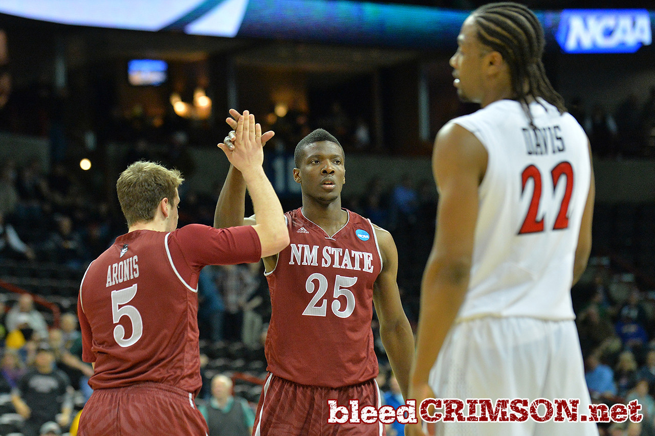 March 20, 2014: New Mexico State Aggies guard Kevin Aronis (5) and New Mexico State Aggies forward Renaldo Dixon (25) celebrate a made basket during a second round game of the NCAA Division I Men's Basketball Championship between the 4-seed San Diego State Aztecs and the 13-seed New Mexico State Aggies at Spokane Arena in Spokane, Wash. San Diego State defeated New Mexico State 73-69 in overtime.