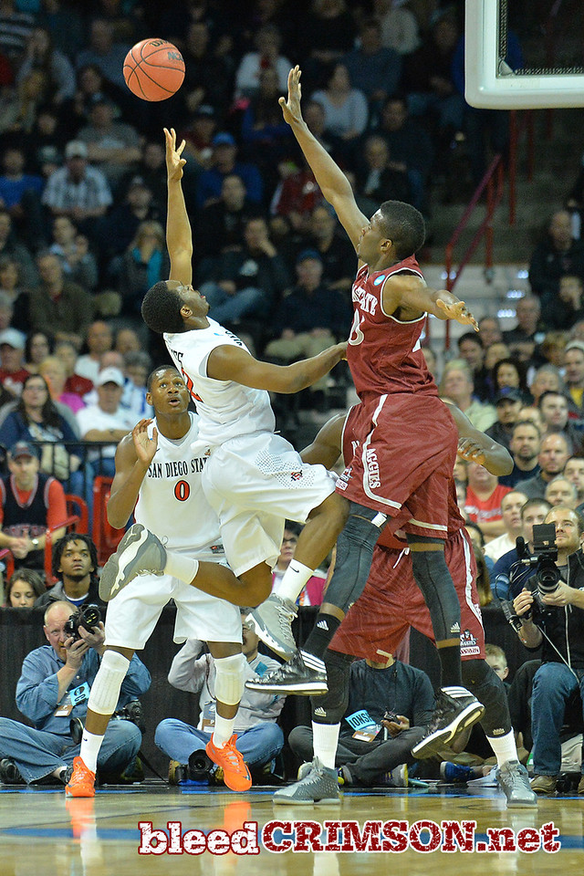 March 20, 2014: New Mexico State Aggies forward Renaldo Dixon (25) contests a shot  during a second round game of the NCAA Division I Men's Basketball Championship between the 4-seed San Diego State Aztecs and the 13-seed New Mexico State Aggies at Spokane Arena in Spokane, Wash. San Diego State defeated New Mexico State 73-69 in overtime.