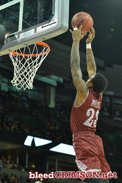 March 20, 2014: New Mexico State Aggies guard Daniel Mullings (23) tries to grab an alley-lop pass during a second round game of the NCAA Division I Men's Basketball Championship between the 4-seed San Diego State Aztecs and the 13-seed New Mexico State Aggies at Spokane Arena in Spokane, Wash. San Diego State defeated New Mexico State 73-69 in overtime.
