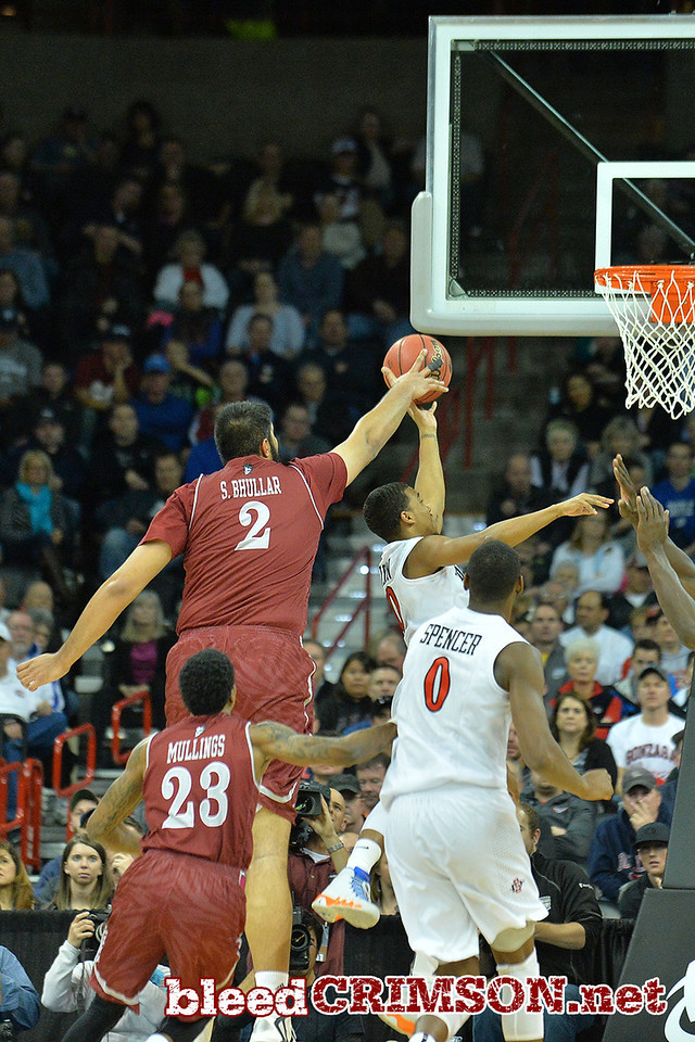 March 20, 2014: New Mexico State Aggies center Sim Bhullar (2) blocks a shot but was called for a foul during a second round game of the NCAA Division I Men's Basketball Championship between the 4-seed San Diego State Aztecs and the 13-seed New Mexico State Aggies at Spokane Arena in Spokane, Wash. San Diego State defeated New Mexico State 73-69 in overtime.