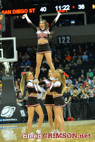 March 20, 2014: Members of the San Diego State Aztecs cheerleading squad perform during a second round game of the NCAA Division I Men's Basketball Championship between the 4-seed San Diego State Aztecs and the 13-seed New Mexico State Aggies at Spokane Arena in Spokane, Wash. San Diego State defeated New Mexico State 73-69 in overtime.