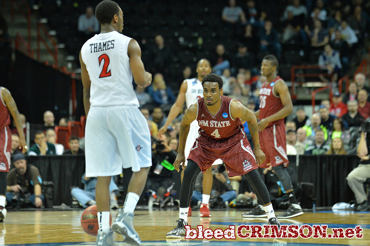March 20, 2014: New Mexico State Aggies guard Ian Baker (4) gets into a defensive stance during a second round game of the NCAA Division I Men's Basketball Championship between the 4-seed San Diego State Aztecs and the 13-seed New Mexico State Aggies at Spokane Arena in Spokane, Wash. San Diego State defeated New Mexico State 73-69 in overtime.