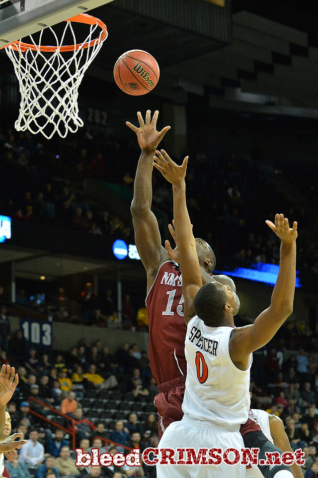 March 20, 2014: New Mexico State Aggies center Tshilidzi Nephawe (15) puts up a shot during a second round game of the NCAA Division I Men's Basketball Championship between the 4-seed San Diego State Aztecs and the 13-seed New Mexico State Aggies at Spokane Arena in Spokane, Wash. San Diego State defeated New Mexico State 73-69 in overtime.