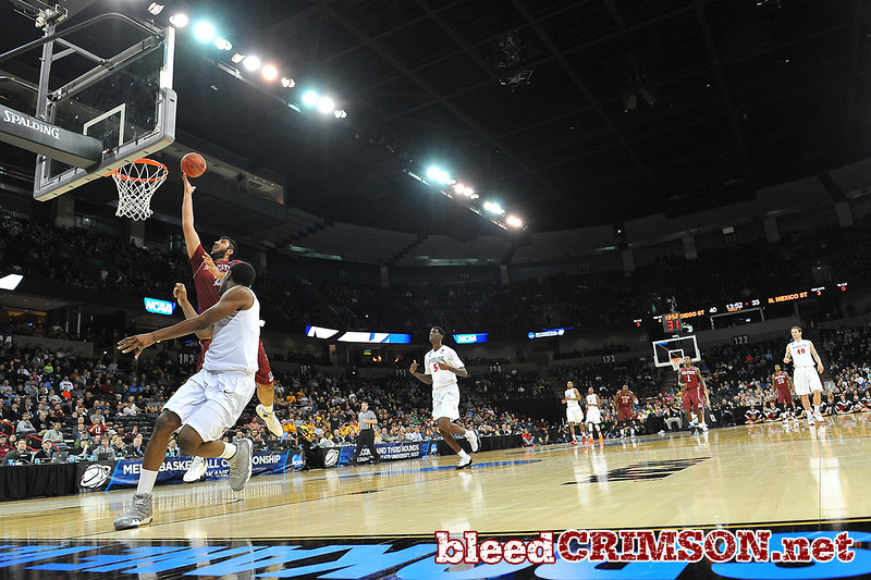 March 20, 2014: New Mexico State Aggies center Sim Bhullar (2) gets a layup on a fast break during a second round game of the NCAA Division I Men's Basketball Championship between the 4-seed San Diego State Aztecs and the 13-seed New Mexico State Aggies at Spokane Arena in Spokane, Wash. San Diego State defeated New Mexico State 73-69 in overtime.