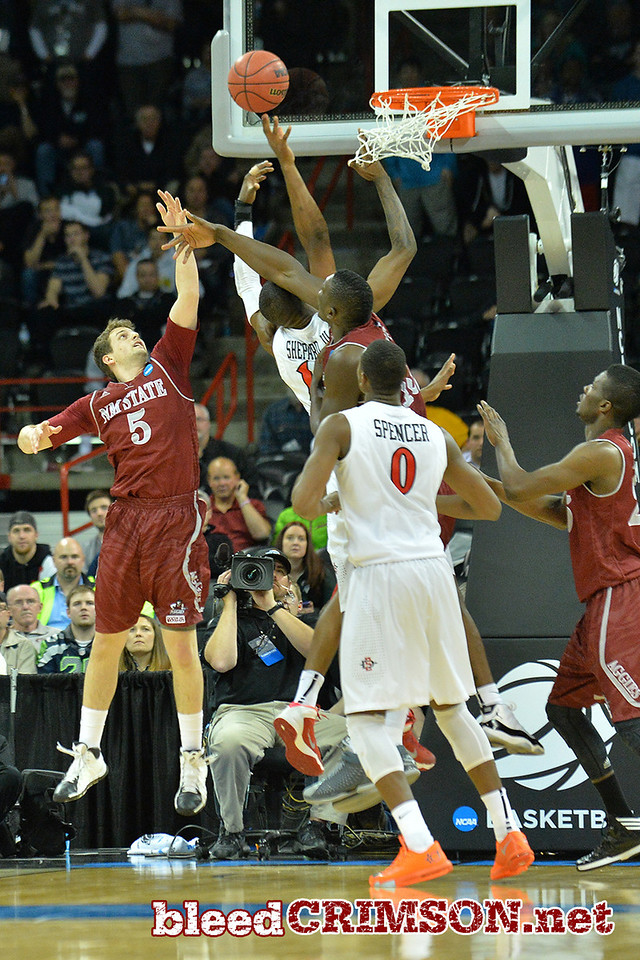 March 20, 2014: New Mexico State Aggies guard Kevin Aronis (5) and New Mexico State Aggies center Tshilidzi Nephawe (15) contest a San Diego State Aztecs shot during a second round game of the NCAA Division I Men's Basketball Championship between the 4-seed San Diego State Aztecs and the 13-seed New Mexico State Aggies at Spokane Arena in Spokane, Wash. San Diego State defeated New Mexico State 73-69 in overtime.