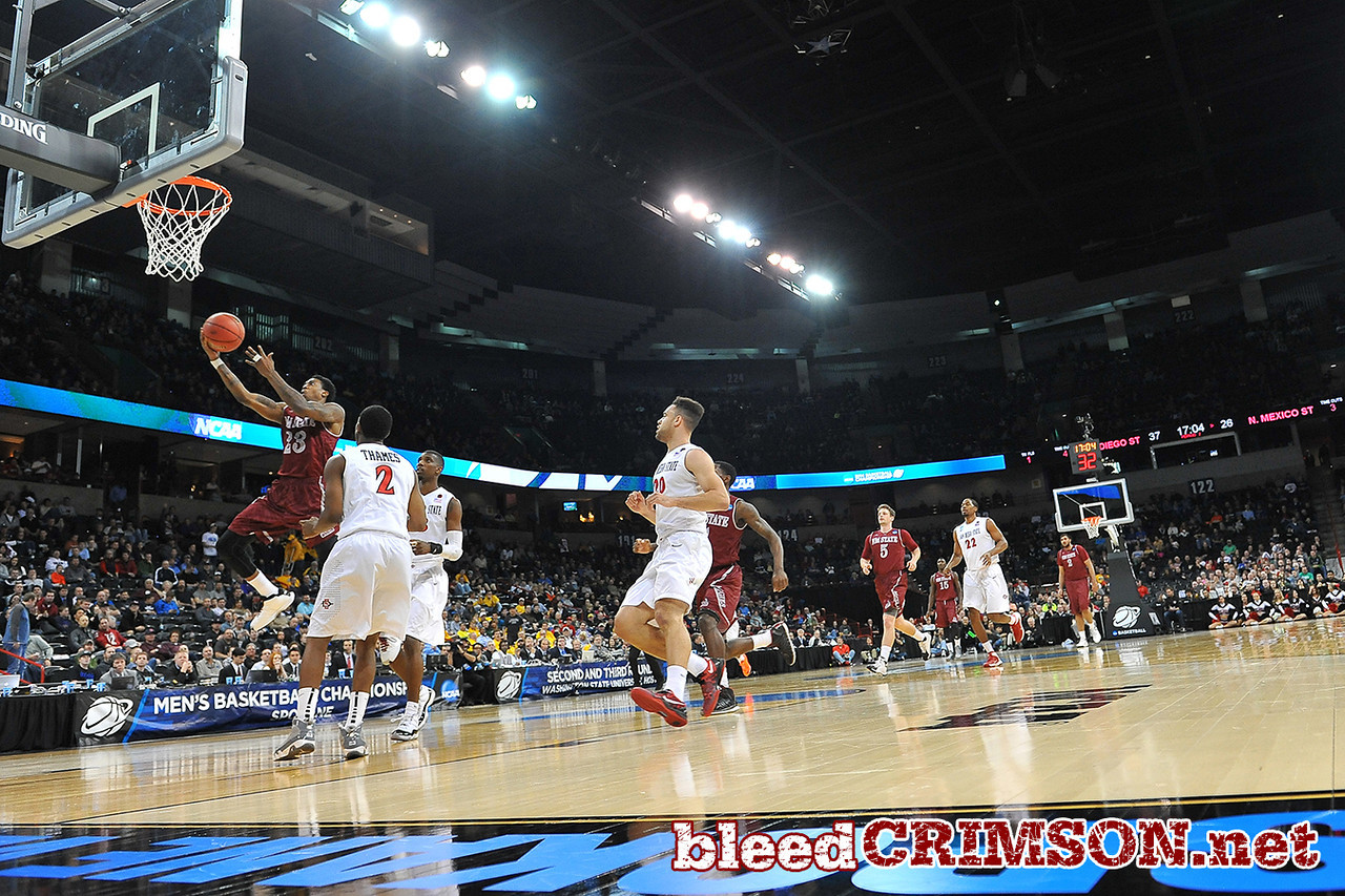 March 20, 2014: New Mexico State Aggies guard Daniel Mullings (23) gets to the rim for a layup during a second round game of the NCAA Division I Men's Basketball Championship between the 4-seed San Diego State Aztecs and the 13-seed New Mexico State Aggies at Spokane Arena in Spokane, Wash. San Diego State defeated New Mexico State 73-69 in overtime.