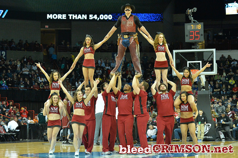 March 20, 2014: Members of the New Mexico State Aggies cheerleading squad perform during a second round game of the NCAA Division I Men's Basketball Championship between the 4-seed San Diego State Aztecs and the 13-seed New Mexico State Aggies at Spokane Arena in Spokane, Wash. San Diego State defeated New Mexico State 73-69 in overtime.
