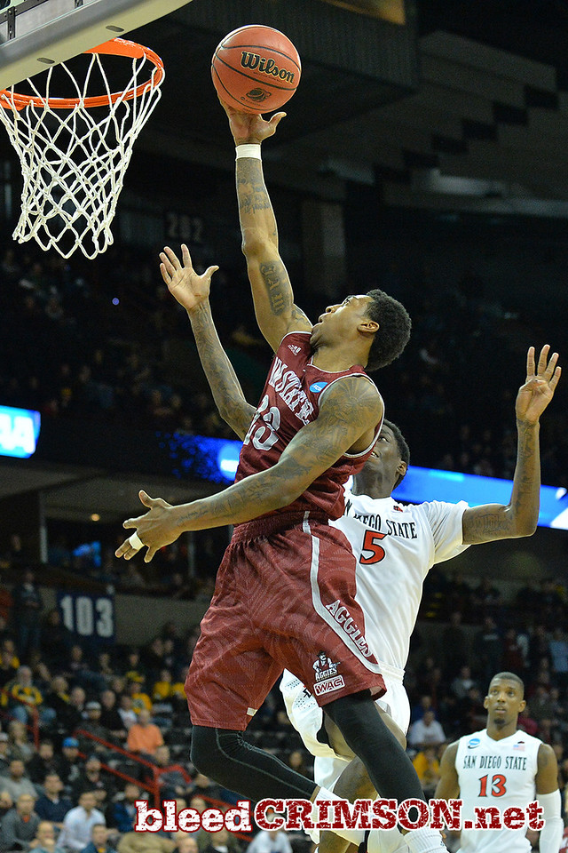 March 20, 2014: New Mexico State Aggies guard Daniel Mullings (23) goes up for a layup attempt during a second round game of the NCAA Division I Men's Basketball Championship between the 4-seed San Diego State Aztecs and the 13-seed New Mexico State Aggies at Spokane Arena in Spokane, Wash. San Diego State defeated New Mexico State 73-69 in overtime.