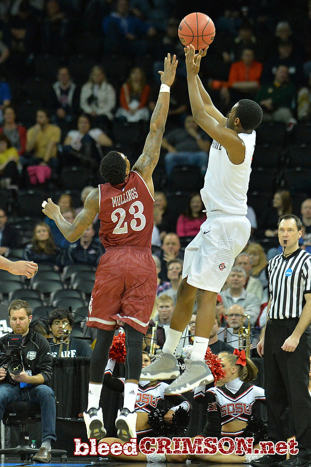 March 20, 2014: New Mexico State Aggies guard Daniel Mullings (23) tries to contest a shot during a second round game of the NCAA Division I Men's Basketball Championship between the 4-seed San Diego State Aztecs and the 13-seed New Mexico State Aggies at Spokane Arena in Spokane, Wash. San Diego State defeated New Mexico State 73-69 in overtime.