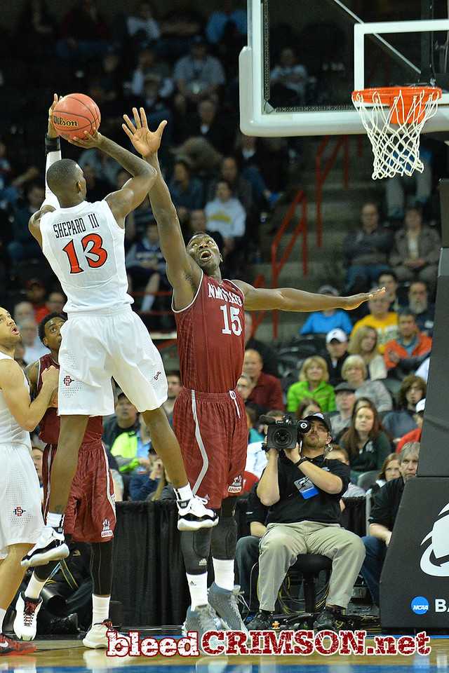 March 20, 2014: New Mexico State Aggies center Tshilidzi Nephawe (15) contests a shot attempt by San Diego State Aztecs forward Winston Shepard (13) during a second round game of the NCAA Division I Men's Basketball Championship between the 4-seed San Diego State Aztecs and the 13-seed New Mexico State Aggies at Spokane Arena in Spokane, Wash. San Diego State defeated New Mexico State 73-69 in overtime.