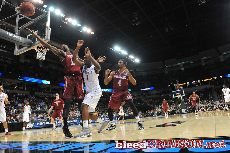 March 20, 2014: A ball goes out of bounds just out of the reach of New Mexico State Aggies forward Renaldo Dixon (25) during a second round game of the NCAA Division I Men's Basketball Championship between the 4-seed San Diego State Aztecs and the 13-seed New Mexico State Aggies at Spokane Arena in Spokane, Wash. San Diego State defeated New Mexico State 73-69 in overtime.