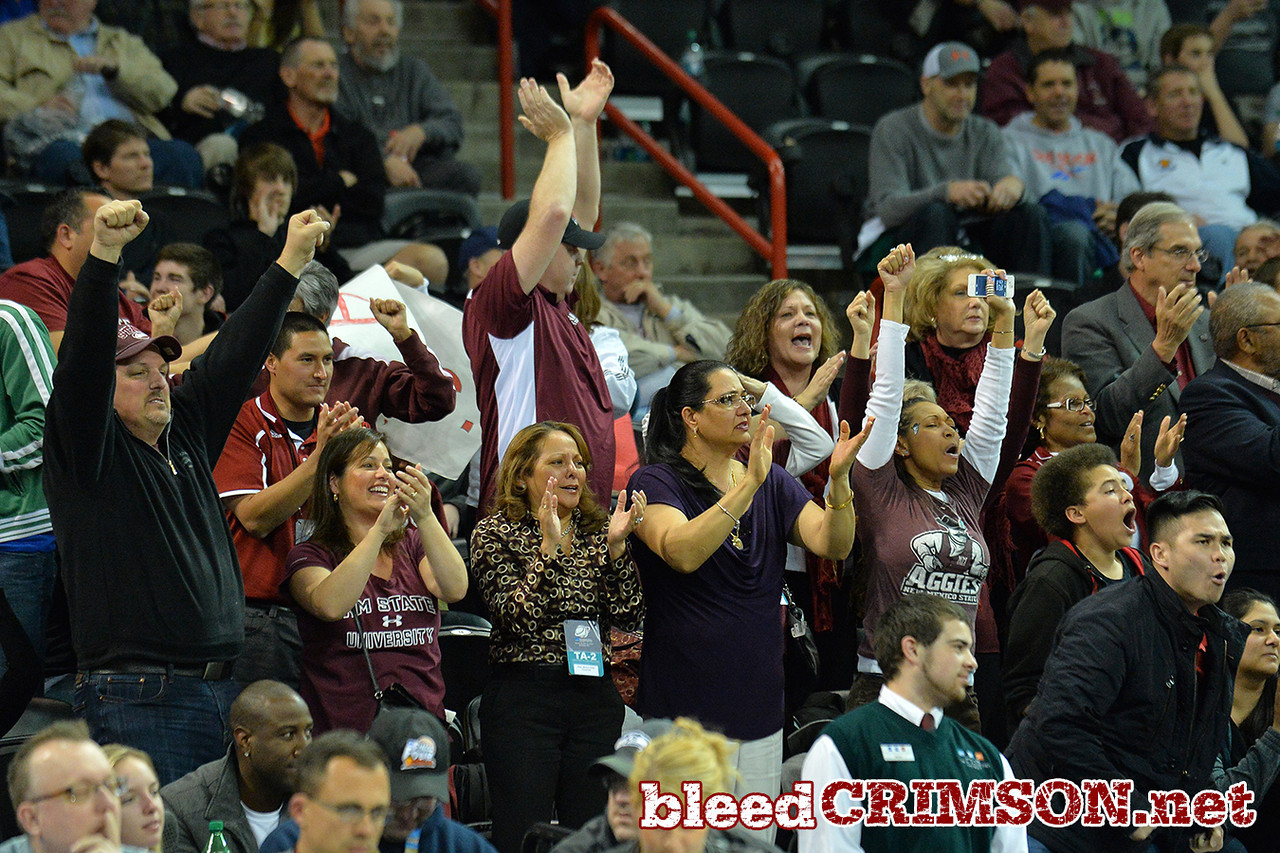 March 20, 2014: New Mexico State Aggies fans celebrate during a second half run during a second round game of the NCAA Division I Men's Basketball Championship between the 4-seed San Diego State Aztecs and the 13-seed New Mexico State Aggies at Spokane Arena in Spokane, Wash. San Diego State defeated New Mexico State 73-69 in overtime.