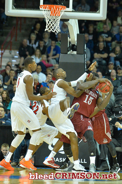 March 20, 2014: New Mexico State Aggies center Tshilidzi Nephawe (15) grabs a rebound during a second round game of the NCAA Division I Men's Basketball Championship between the 4-seed San Diego State Aztecs and the 13-seed New Mexico State Aggies at Spokane Arena in Spokane, Wash. San Diego State defeated New Mexico State 73-69 in overtime.