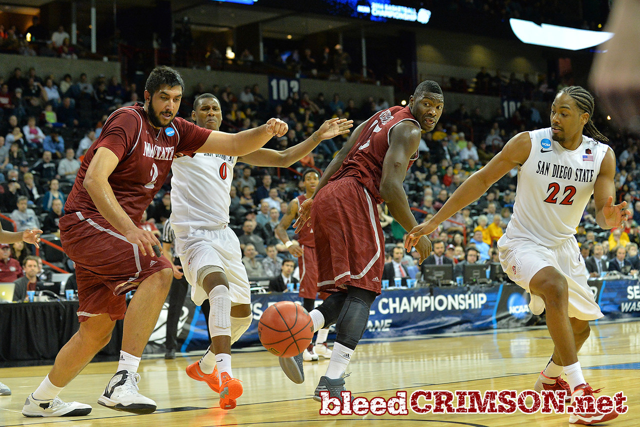 March 20, 2014: New Mexico State Aggies center Sim Bhullar (2) battles for a loose ball during a second round game of the NCAA Division I Men's Basketball Championship between the 4-seed San Diego State Aztecs and the 13-seed New Mexico State Aggies at Spokane Arena in Spokane, Wash. San Diego State defeated New Mexico State 73-69 in overtime.