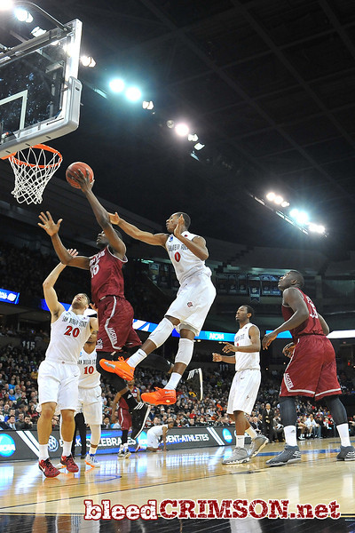 March 20, 2014: New Mexico State Aggies forward Renaldo Dixon (25) goes up for a lyaup during a second round game of the NCAA Division I Men's Basketball Championship between the 4-seed San Diego State Aztecs and the 13-seed New Mexico State Aggies at Spokane Arena in Spokane, Wash. San Diego State defeated New Mexico State 73-69 in overtime.