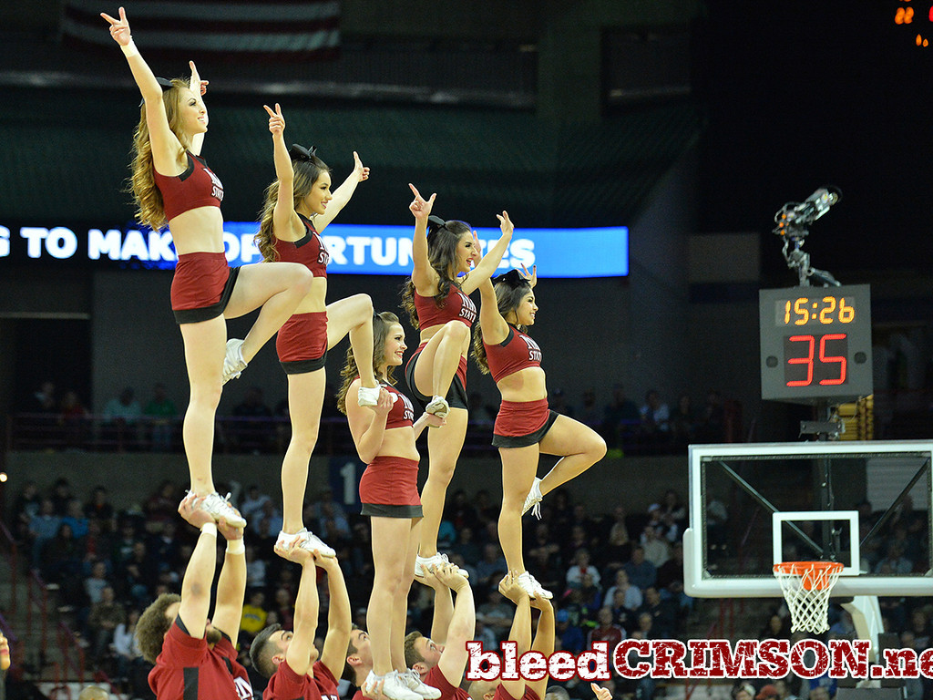 March 20, 2014: New Mexico State Aggies cheerleaders perform during a second round game of the NCAA Division I Men's Basketball Championship between the 4-seed San Diego State Aztecs and the 13-seed New Mexico State Aggies at Spokane Arena in Spokane, Wash. San Diego State defeated New Mexico State 73-69 in overtime.