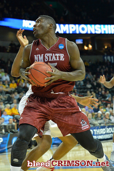 March 20, 2014: New Mexico State Aggies center Tshilidzi Nephawe (15) looks to get to the basket during a second round game of the NCAA Division I Men's Basketball Championship between the 4-seed San Diego State Aztecs and the 13-seed New Mexico State Aggies at Spokane Arena in Spokane, Wash. San Diego State defeated New Mexico State 73-69 in overtime.