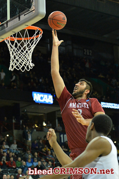 March 20, 2014: New Mexico State Aggies center Sim Bhullar (2) gets a fast break layup during a second round game of the NCAA Division I Men's Basketball Championship between the 4-seed San Diego State Aztecs and the 13-seed New Mexico State Aggies at Spokane Arena in Spokane, Wash. San Diego State defeated New Mexico State 73-69 in overtime.