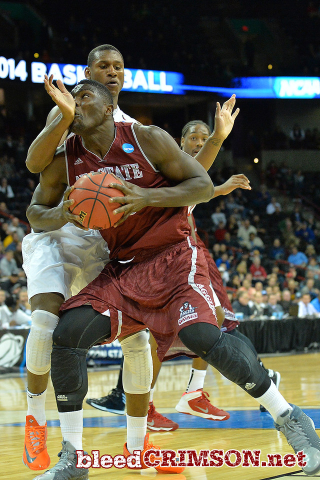 March 20, 2014: New Mexico State Aggies center Tshilidzi Nephawe (15) tries to get to the basket during a second round game of the NCAA Division I Men's Basketball Championship between the 4-seed San Diego State Aztecs and the 13-seed New Mexico State Aggies at Spokane Arena in Spokane, Wash. San Diego State defeated New Mexico State 73-69 in overtime.