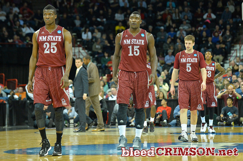 March 20, 2014: New Mexico State Aggies forward Renaldo Dixon (25), New Mexico State Aggies center Tshilidzi Nephawe (15), New Mexico State Aggies guard Kevin Aronis (5) and New Mexico State Aggies guard Daniel Mullings (23) walk back onto the court after a timeout during a second round game of the NCAA Division I Men's Basketball Championship between the 4-seed San Diego State Aztecs and the 13-seed New Mexico State Aggies at Spokane Arena in Spokane, Wash. San Diego State defeated New Mexico State 73-69 in overtime.