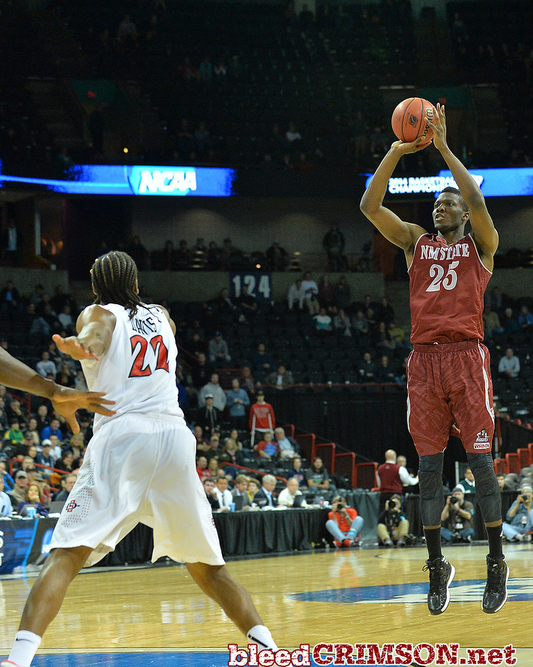 March 20, 2014: New Mexico State Aggies forward Renaldo Dixon (25) shoots a three pointer during a second round game of the NCAA Division I Men's Basketball Championship between the 4-seed San Diego State Aztecs and the 13-seed New Mexico State Aggies at Spokane Arena in Spokane, Wash. San Diego State defeated New Mexico State 73-69 in overtime.