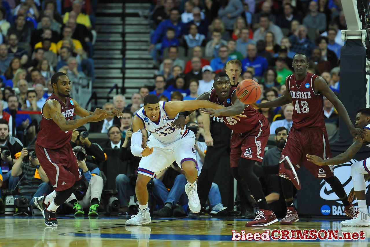 March 20, 2015: New Mexico State Aggies center Tshilidzi Nephawe (15) and Kansas Jayhawks forward Landen Lucas (33) battle for a loose ball during a second round game between No. 15 New Mexico State and No. 15 Kansas in the 2015 NCAA Men's Basketball Championship Tournament at CenturyLink Center in Omaha, Neb.