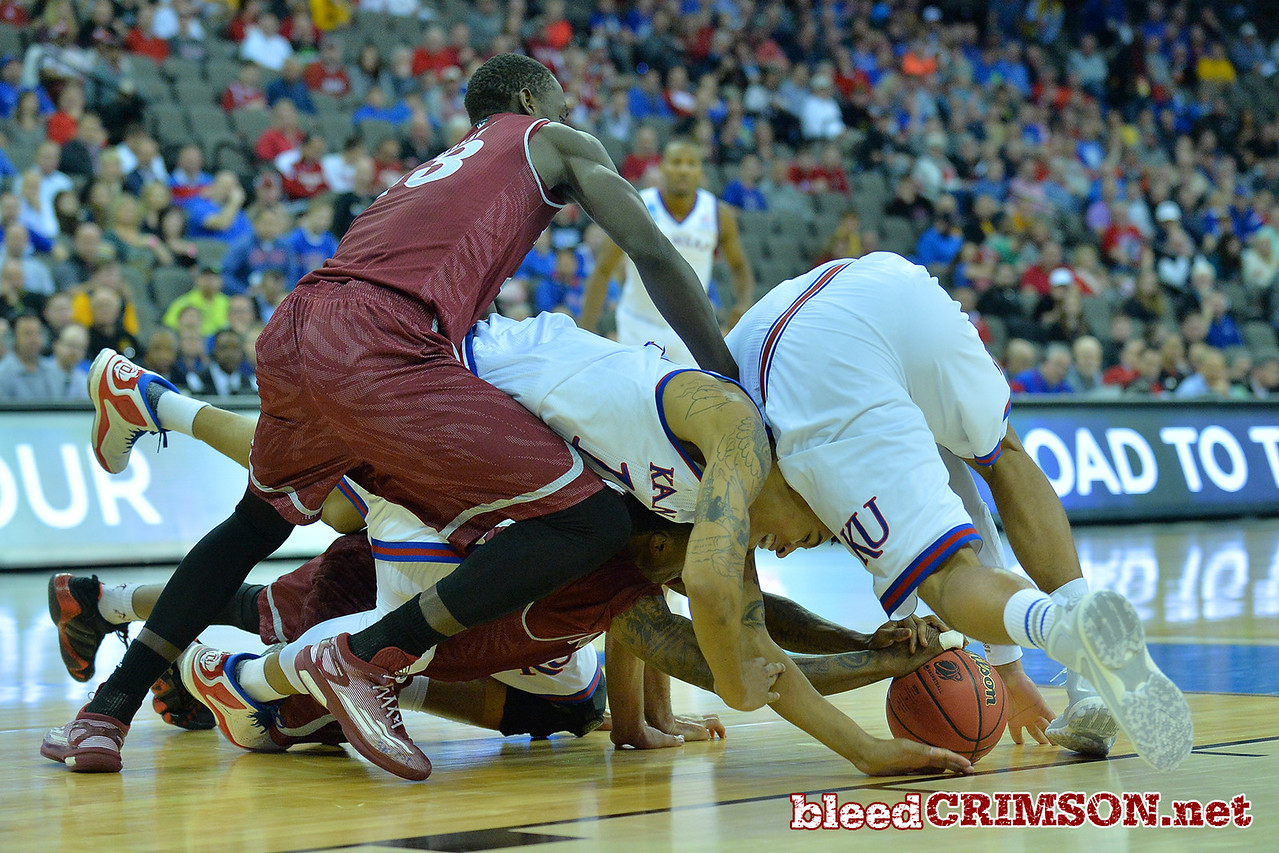 March 20, 2015: New Mexico State Aggies and Kansas Jayhawks players battle for a loose ball during a second round game between No. 15 New Mexico State and No. 15 Kansas in the 2015 NCAA Men's Basketball Championship Tournament at CenturyLink Center in Omaha, Neb.