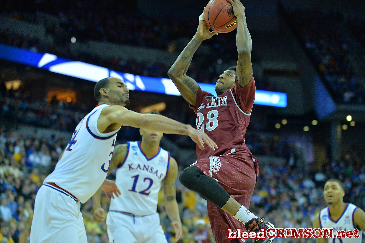 March 20, 2015: New Mexico State Aggies guard Daniel Mullings (23) drives to the basket in the first half during a second round game between No. 15 New Mexico State and No. 2 Kansas in the 2015 NCAA Men's Basketball Championship Tournament at CenturyLink Center in Omaha, Neb.