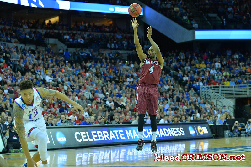 March 20, 2015: New Mexico State Aggies guard Ian Baker (4) shoots a shot during a second round game between No. 15 New Mexico State and No. 15 Kansas in the 2015 NCAA Men's Basketball Championship Tournament at CenturyLink Center in Omaha, Neb.