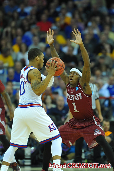 March 20, 2015: New Mexico State Aggies guard DK Eldridge (1) guards Kansas Jayhawks guard Frank Mason III (0) during a second round game between No. 15 New Mexico State and No. 15 Kansas in the 2015 NCAA Men's Basketball Championship Tournament at CenturyLink Center in Omaha, Neb.