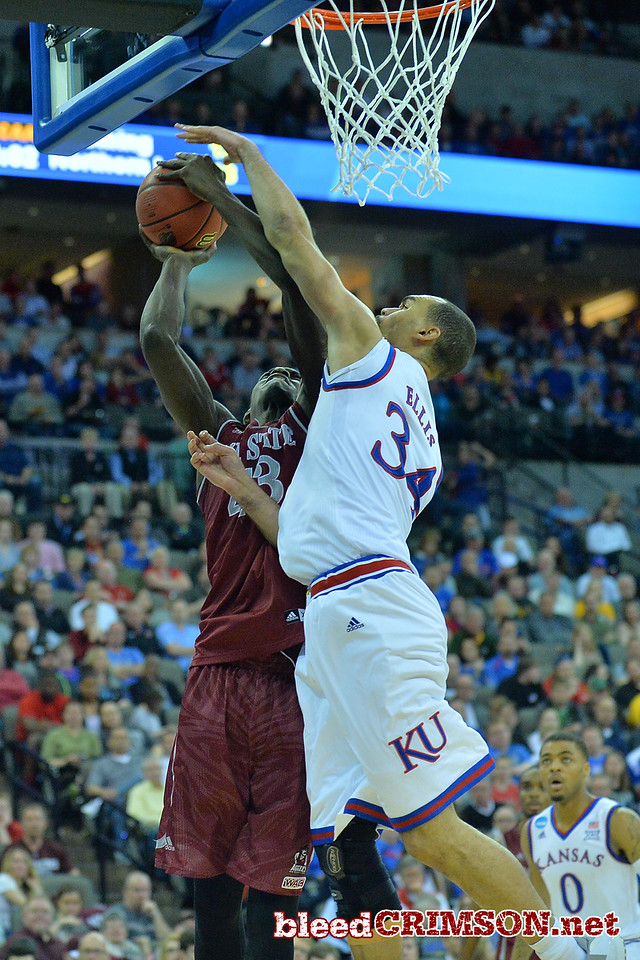 March 20, 2015: New Mexico State Aggies forward Pascal Siakam (43) tries to put up a shot against Kansas Jayhawks forward Perry Ellis (34) during a second round game between No. 15 New Mexico State and No. 15 Kansas in the 2015 NCAA Men's Basketball Championship Tournament at CenturyLink Center in Omaha, Neb.