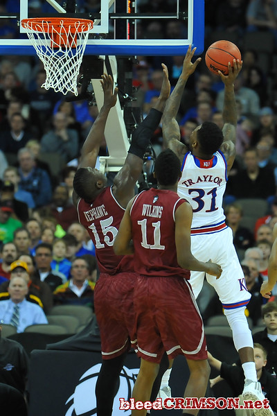 March 20, 2015: New Mexico State Aggies center Tshilidzi Nephawe (15) defends a shot attempt from Kansas Jayhawks forward Jamari Traylor (31) during a second round game between No. 15 New Mexico State and No. 15 Kansas in the 2015 NCAA Men's Basketball Championship Tournament at CenturyLink Center in Omaha, Neb.