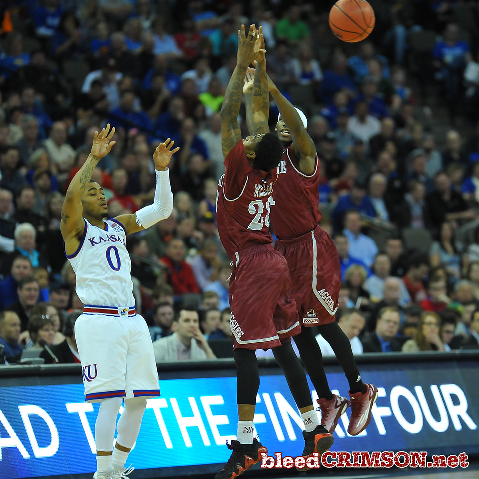 March 20, 2015: New Mexico State Aggies guard Daniel Mullings (23) and New Mexico State Aggies guard DK Eldridge (1) guard Kansas Jayhawks guard Frank Mason III (0) during a second round game between No. 2 Kansas and No. 15 New Mexico State in the 2015 NCAA Men's Basketball Championship Tournament at CenturyLink Center in Omaha, Neb.