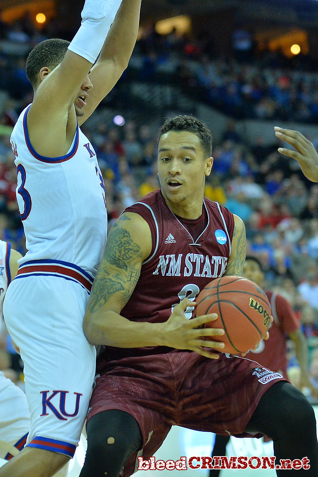 March 20, 2015: New Mexico State Aggies forward Remi Barry (3) drives into the defense during a second round game between No. 15 New Mexico State and No. 15 Kansas in the 2015 NCAA Men's Basketball Championship Tournament at CenturyLink Center in Omaha, Neb.