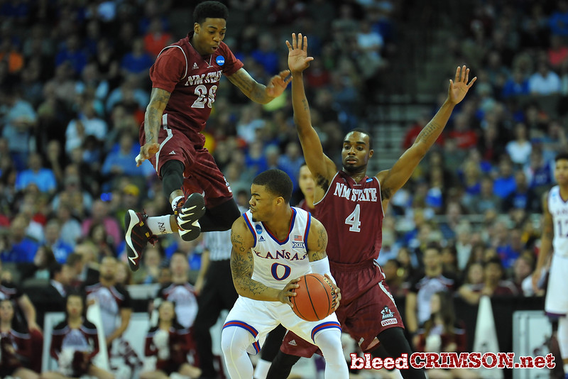 March 20, 2015: New Mexico State Aggies guard Daniel Mullings (23) leaps in the air on defense during a second round game between No. 15 New Mexico State and No. 15 Kansas in the 2015 NCAA Men's Basketball Championship Tournament at CenturyLink Center in Omaha, Neb.