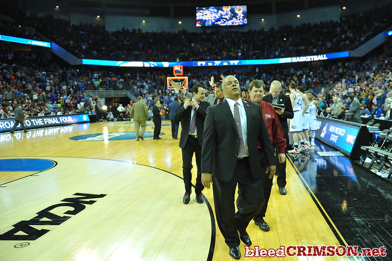 March 20, 2015: New Mexico State Aggies head coach Marvin Menzies walks off the court after a second round game between No. 2 Kansas and No. 15 New Mexico State in the 2015 NCAA Men's Basketball Championship Tournament at CenturyLink Center in Omaha, Neb.