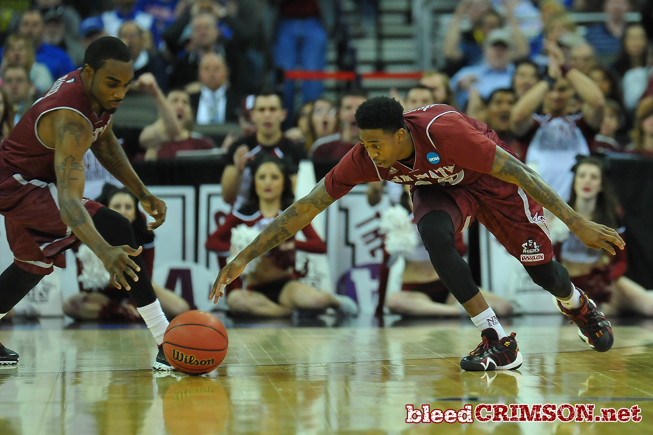 March 20, 2015: New Mexico State Aggies guard Daniel Mullings (23) scrambles for a loose ball during a second round game between No. 15 New Mexico State and No. 15 Kansas in the 2015 NCAA Men's Basketball Championship Tournament at CenturyLink Center in Omaha, Neb.
